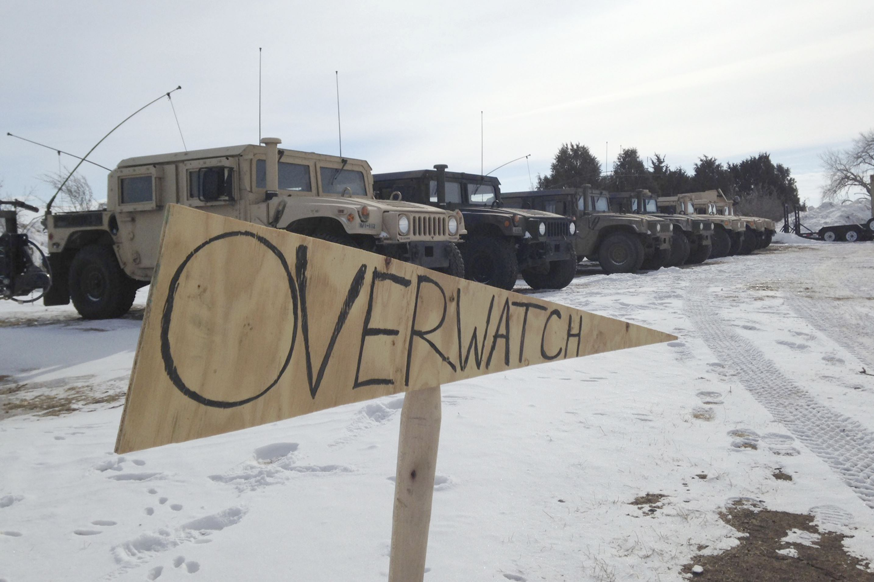 Oil Pipeline Military vehicles are staged near the path of the Dakota Access pipeline Thursday near Cannon Ball, N.D.