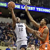 Pitt's Chris Jones drives to the net against Syracuse's Taurean Thompson in the first half Saturday at Petersen Events Center.