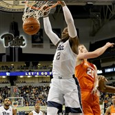Pitt's Michael Young dunks against Syracuse's Tyler Lydon in the second half Saturday at Petersen Events Center.