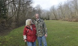 Gretchen Rheinlander and her husband David look over a part of their property near Burgettstown. Energy Transfer Partners has sued the Rheinlanders to condemn a portion of their property so the company can build a natural gas pipeline through it after the landowners refused to give their consent.