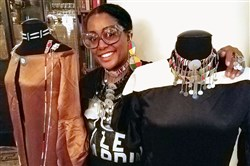 "Tereneh Mosley of the North Side stands with pieces from the fall 2017 Idia'Dega Fashion ""Healing Collection,"" her collaboration with the Olorgesailie Maasai women's artisan group in Kenya and the Oneida Indian Nation in New York."