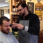 The Humble Barber Brad Richards cuts Brad Kovach's hair.
