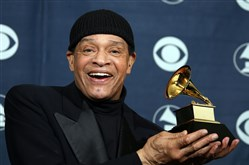 Al Jarreau posing with his trophy at the 49th Grammy Awards in Los Angeles .