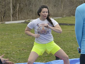 Jane Binakonsky runs through a series of conditioning and breathing exercises before entering the icy water at Peters Lake Park.