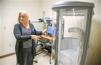 Director Lynda Glagola talks about a machine that tests lung function at Lungs at Work, a free health care clinic for coal miners in McMurray.