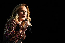 British singer Adele performs onstage during the 59th Annual Grammy music Awards on Sunday.