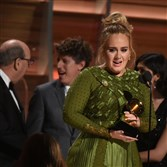 Adele talks to Beyonce as she receives the Best album of the year during the 59th Annual Grammy music Awards on Sunday in Los Angeles.