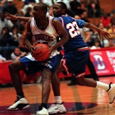 Duquesne's Mike James drives past a Morgan State defender during a December 1997 games.