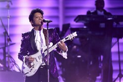Bruno Mars performs a tribute to Prince at the 59th annual Grammy Awards.