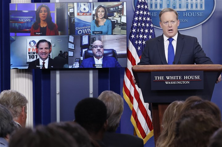 Trump White House press secretary Sean Spicer takes questions from reporters displayed on screens using Skype during the daily news briefing at the White House in Washington, D.C., on Feb. 1.