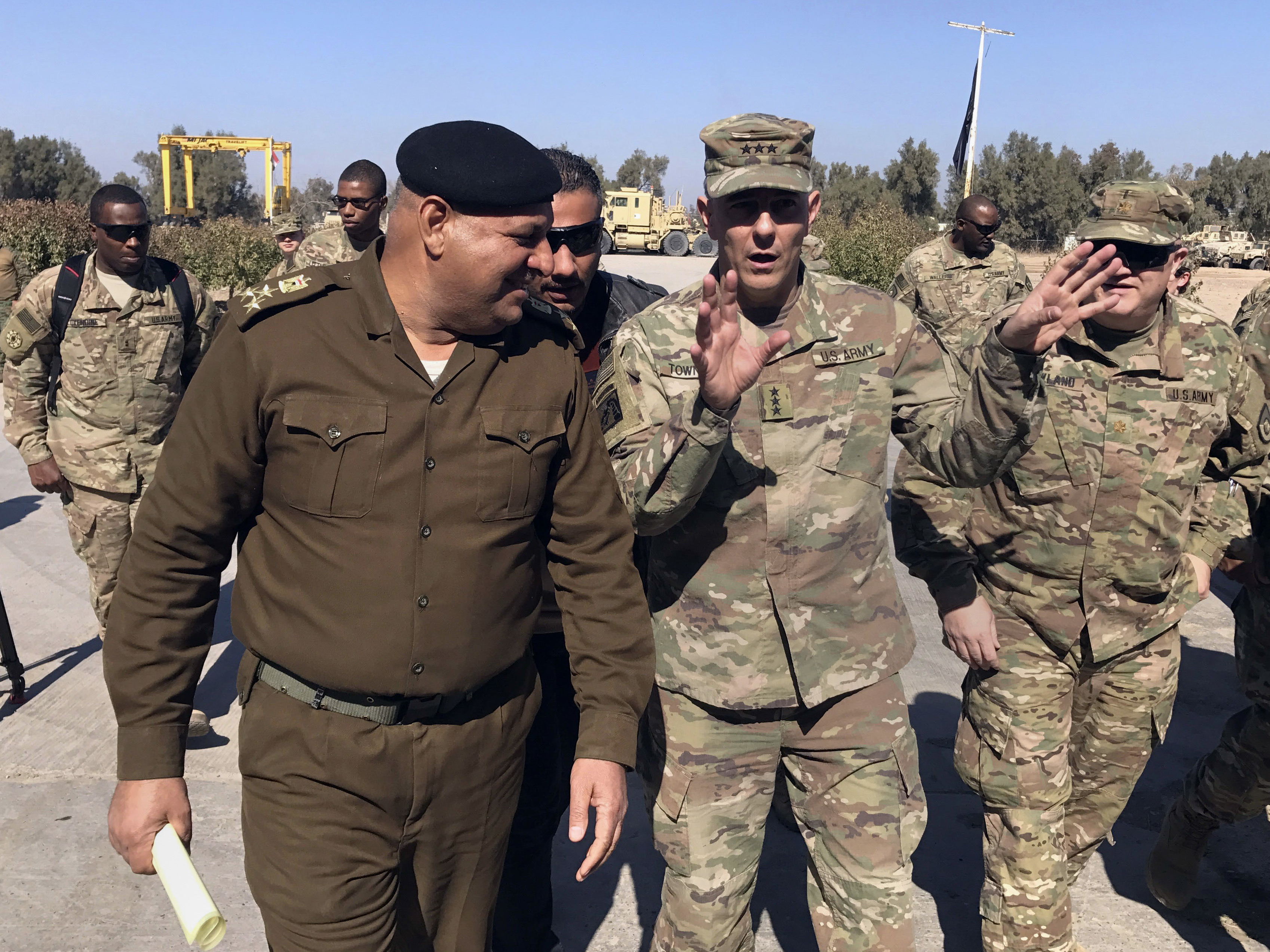 Iraq US-1 FILE - In this Wednesday, Feb. 8, 2017 file photo, U.S. Army Lt. Gen. Stephen Townsend talks with an Iraqi officer during a tour north of Baghdad, Iraq. Reverberations from President Donald Trump's travel ban and other stances are threatening to undermine future U.S.-Iraqi security cooperation, rattling a key alliance that over the past two years has slowly beaten back the Islamic State group. Iraq's prime minister, Haider al-Abadi, has sought to contain public anger sparked by the ban and by Trump's repeated statements that the Americans should have taken Iraq's oil, as well as his hard line against Iran, a close ally of Baghdad. (AP Photo/Ali Abdul Hassan, File)