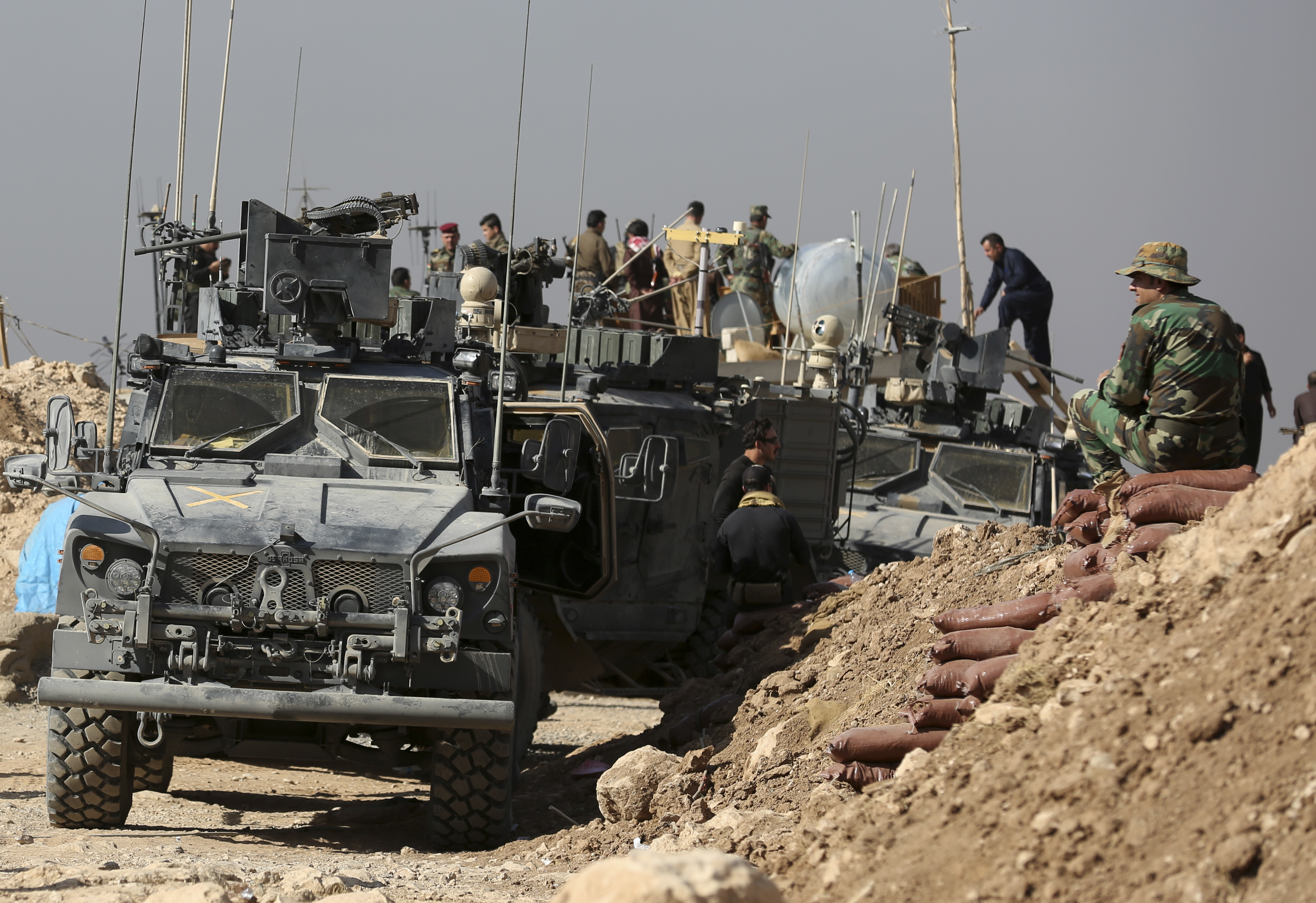 Iraq US-5 In this Friday, Oct. 21, 2016 photo, U.S. and Iraqi forces work together at a joint base, on the outskirts of Mosul, Iraq. Reverberations from President Donald Trump's travel ban and other stances are threatening to undermine future U.S.-Iraqi security cooperation, rattling a key alliance that over the past two years has slowly beaten back the Islamic State group. Iraq's prime minister, Haider al-Abadi, has sought to contain public anger sparked by the ban and by Trump's repeated statements that the Americans should have taken Iraq's oil, as well as his hard line against Iran, a close ally of Baghdad. (AP Photo/Khalid Mohammed)