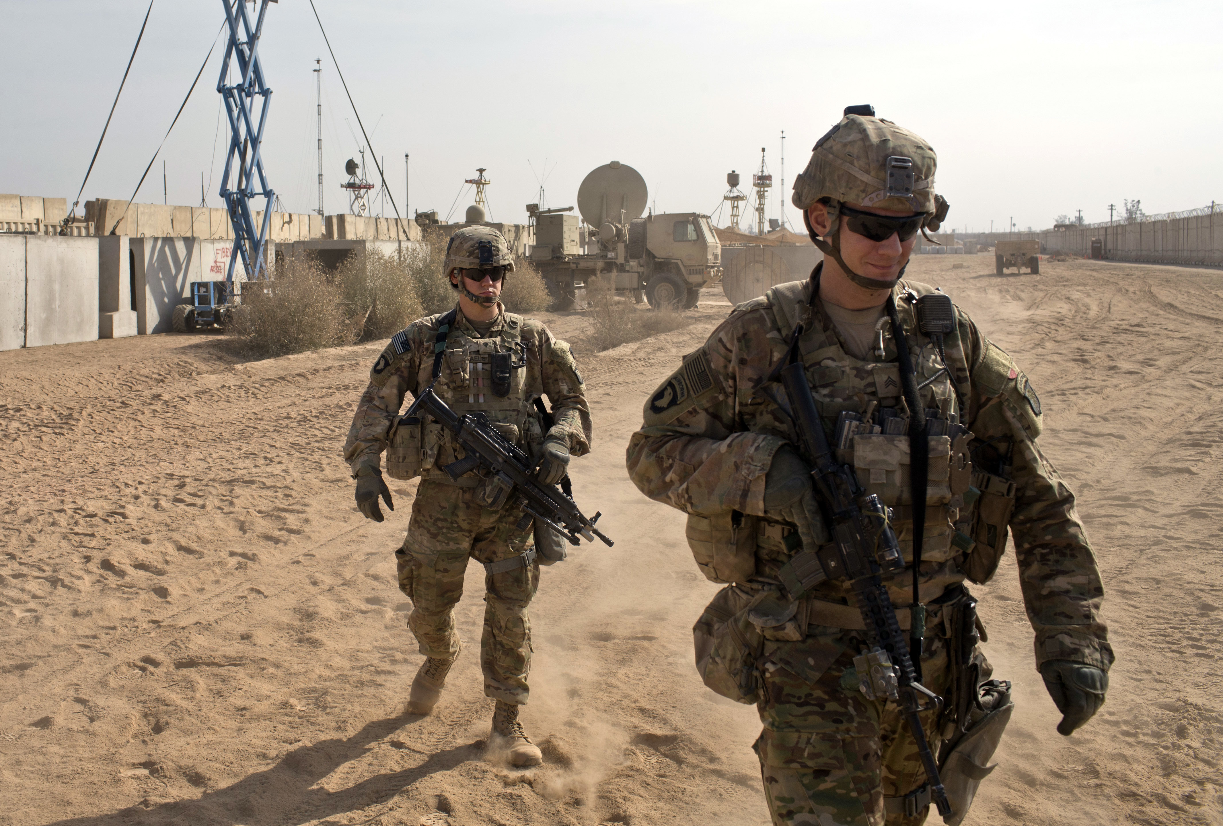 Iraq US FILE - In this Nov. 9, 2016 file photo, U.S. Army soldiers move through Qayara West Coalition base in Qayara, some 50 kilometers south of Mosul, Iraq. Reverberations from President Donald Trump's travel ban and other stances are threatening to undermine future U.S.-Iraqi security cooperation, rattling a key alliance that over the past two years has slowly beaten back the Islamic State group. Iraq's prime minister, Haider al-Abadi, has sought to contain public anger sparked by the ban and by Trump's repeated statements that the Americans should have taken Iraq's oil, as well as his hard line against Iran, a close ally of Baghdad. (AP Photo/Marko Drobnjakovic, File)