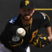 Pirates right hander Drew Hutchison delivers off the bullpen mound during workouts Feb. 16.