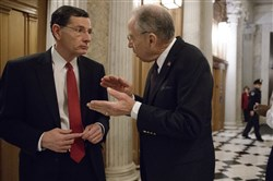 Senate Environment and Public Works Committee Chairman Sen. John Barrasso, R-Wyo., left, confers with Senate Judiciary Committee Chairman Sen. Chuck Grassley, R-Iowa on Capitol Hill in Washington, D.C., on Feb. 3.