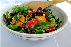 A touch of honey in the dressing highlights the sweetness of the oranges in this citrus salad with mixed greens and avocado.