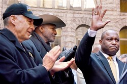Steelers owner Art Rooney II and former Steeler Mel Blount applaud as Common Pleas Judge Dwayne Woodruff waves to supporters after announcing his bid for the Pennsylvania Supreme Court, in the Courtyard of the Allegheny County Courthouse in Downtown Pittsburgh earlier this month.