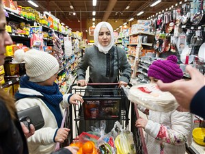 Syrian refugee Kholoud Alteara, center, 30, of Lincoln Place, holds on to her shopping cart as she and her family visit their neighborhood Giant Eagle for the first time with Jewish Family and Children Services senior refugee case worker Sawsan Alobaidi, far left, 47, of Greentree, one day after the family arrived as refugees from where they were living in Cairo. Alobaidi walked them through the supermarket, showing them how to find the least-expensive foods with the most value and stay in their budget.
