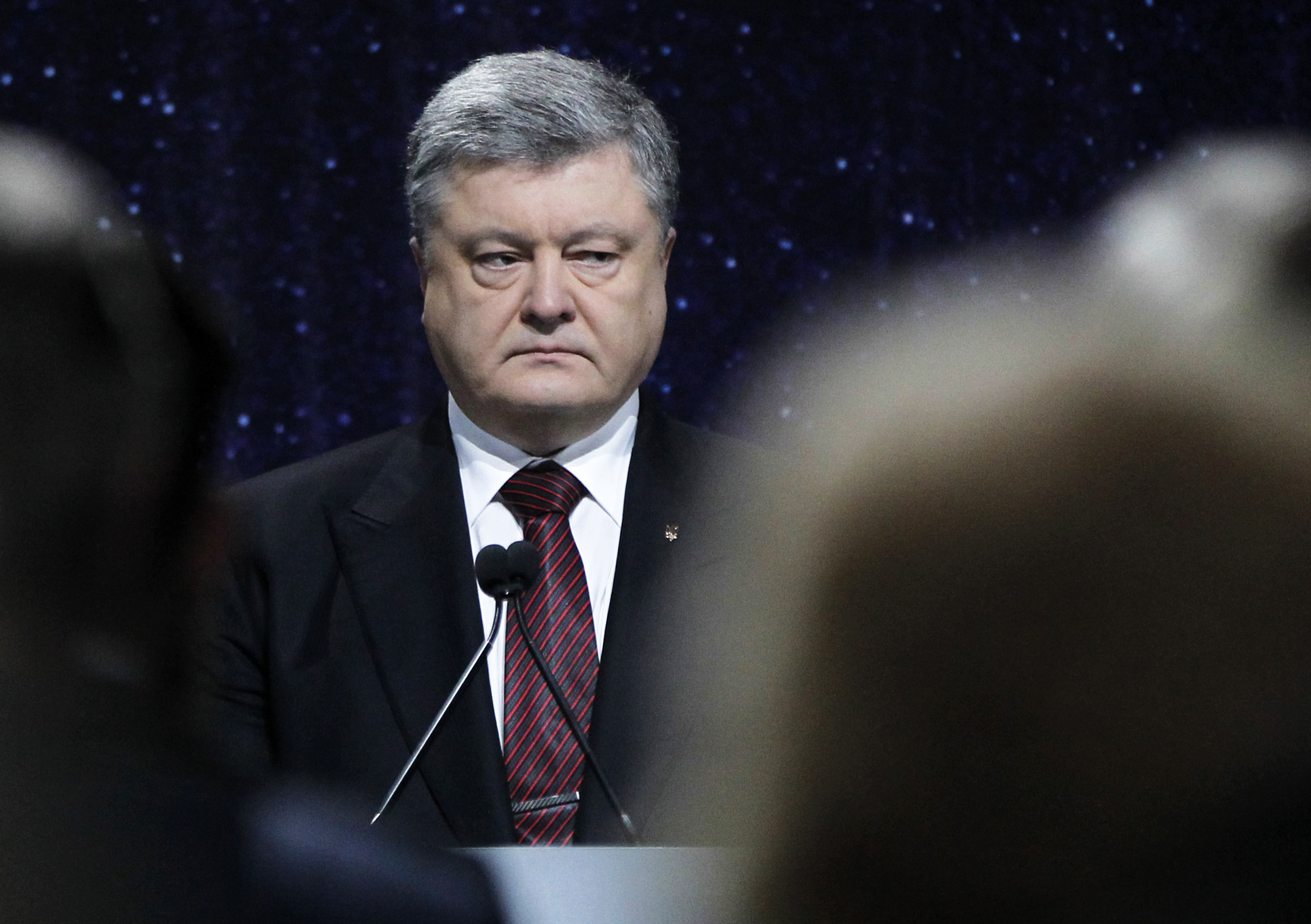 "Ukraine-4 Ukrainian President Petro Poroshenko looks on at during the ceremony commemorating the fallen Heroes of the ""Heavenly Hundred"" in Kiev, Ukraine, Thursday, Feb. 16, 2017. The ""Heavenly Hundred"" is what Ukrainians in Kiev call those who died during months of anti-government protests in 2013 and 2014. (AP Photo/Sergei Chuzavkov)"