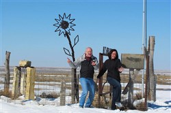 Kenn Howard and Lisa Squiers celebrate reaching the top of Mount Sunflower, Kansas, in March 2013.