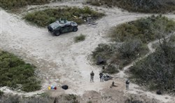 In this Feb. 24, 2015, file photo, members of the National Guard patrol along the Rio Grande at the Texas-Mexico border in Rio Grande City, Texas.