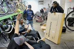 Braddock native Sterling Stone, executive director of Gearin' Up Bicycles, meets with youth mechanics in Washington, D.C.