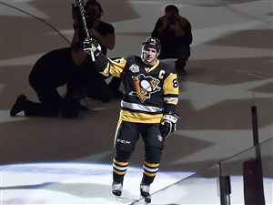 Penguins center Sidney Crosby is introduced as the number one star after notching his 1000th career point in the first period against the Winnipeg Jets Thursday, Feb. 16, at PPG Paints Arena.