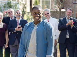 "Daniel Kaluuya as Chris Washington, center, is the guest of a very odd garden party in ""Get Out."""