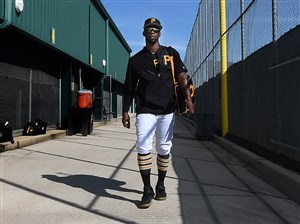 Pirates Andrew McCutchen makes his way to the field on the first day of full squad workouts Feb. 17 in Bradenton, Fla.