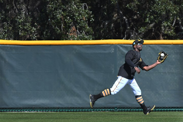 20170217pdPiratesSports08-7 Pirates right fielder Andrew McCutchen makes a catch Friday during the first day of full squad workouts in Bradenton, Fla.