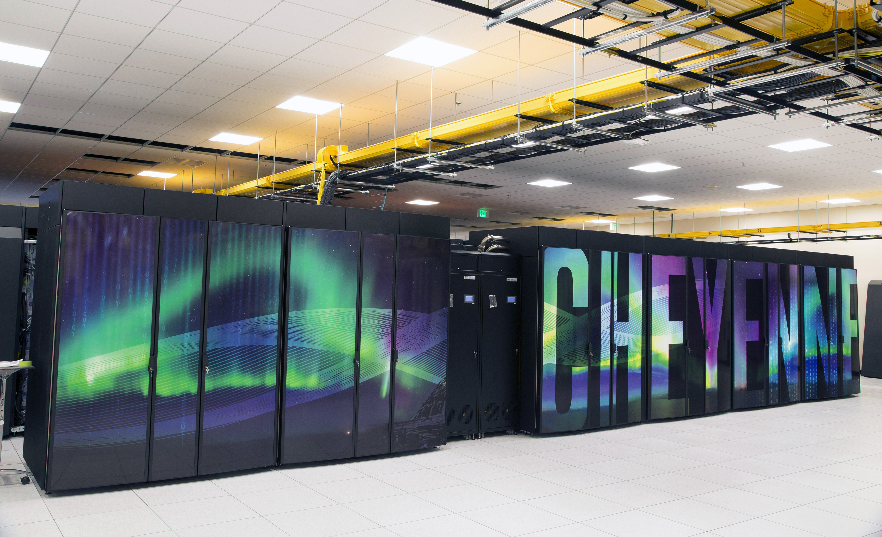 Climate Supercomputer This Oct. 26, 2016 photo provided by the University Corporation for Atmospheric Research shows the new supercomputer named Cheyenne at the National Center for Atmospheric Research at the supercomputing center in Cheyenne, Wyo. Wyoming officials including Gov. Matt Mead say they support the NCAR-Wyoming Supercomputing Center even as they describe themselves as climate skeptics. Scientists nationwide are nonetheless concerned that President Donald Trump, who has called climate change a hoax, might not take climate change research seriously. (Carlye Calvin/ University Corporation for Atmospheric Research via AP)