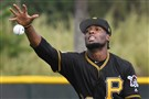Pittsburgh Pirates Alen Hanson reaches for ground ball during workouts Saturday at Pirate City in Bradenton, Florida.