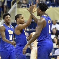 Pitt's Justice Kitchcart congratulates Jamel Artis in the final second of their team's win against Florida State on Saturday.