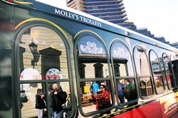 Tourists get off Molly's Trolly at Duquesne Incline on Mt. Washington on Saturday. Molly's Trolleys have been a regular presence in Pittsburgh for 22 years, taking people to weddings, receptions, and on theme tours.