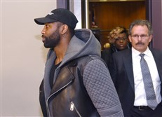 Aliquippa native and New York Jet Darrelle Revis, left, and defense attorney Bobby Del Greco Jr., leave the Pittsburgh Municipal Court Building on Friday after Mr. Revis' arraignment hearing.