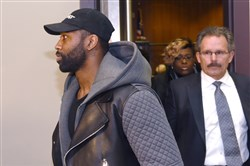 Darrelle Revis and attorney Bobby Del Greco leave  the Pittsburgh Municipal Courts Building after Revis' arraignment on Friday.