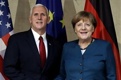 United States Vice President Mike Pence, left, and German Chancellor Angela Merkel meet for bilateral talks during the Munich Security Conference in Munich, Germany, Saturday.