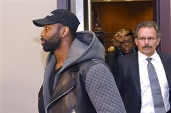 Aliquippa native and New York Jet Darrelle Revis, left, and his new lawyer, Bobby Del Greco, right, leave  the Pittsburgh Municipal Courts Building after the arraignment Friday evening in Pittsburgh. Mr. Del Greco is his attorney now in the trial phase.