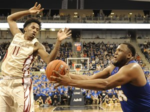 Pitt's Rozelle Nix grabs a rebound against Florida State's Braian Angola-Rodas in the first half of Saturday's game in Oakland.