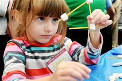 Nate Guidry/Post-Gazette. 20170219. For Local. Reporter Gretchen McKay.Clara Cheyre, 4, of Fox Chapel, builds crystal structure with marshmallows during Carnegie Mellon University's  first annual Explore Engineering! Festival Feb. 19, 2017. The festival together hundreds of K-12 students from across the Pittsburgh region to explore their interest in engineering through a day of hands-on demos.