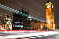 "A slogan reading ""Say No to Trump"" is seen projected on the Houses of Parliament on Sunday, the evening before a parliamentary debate on President Donald Trump's state visit is due to take place in London."