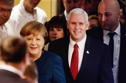 German Chancellor Angela Merkel and Vice President Mike Pence arrive Saturday for the second day of the 2017 Munich Security Conference in Munich, Germany.