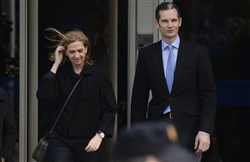 In this Feb. 9, 2016 file photo, Spain's Princess Cristina and her husband Inaki Urdangarin, leave a courtroom after attending a corruption trial, in Palma de Mallorca, Spain. A Spanish court  on Friday Feb. 17, 2017, found Princess Cristina not guilty in a tax fraud case in which her husband, the brother-in-law of King Felipe VI, was sentenced Friday to 6 years and 3 months in prison for evading taxes, fraud and various other charges.