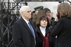 Vice President Mike Pence, left, and his wife, Karen, listen to a guide during a visit to the former Nazi concentration camp in Dachau near Munich on Sunday, one day after he attended the Munich Security Conference.