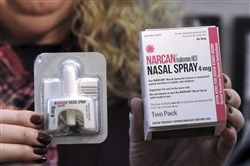 Pennsylvania Physician General Dr. Rachel Levine holds a sample of Narcan Nasal Spray following a demonstration on how to fill a prescription at Walgreens Pharmacy in Wilkes-Barre, Pa. in February 2017.