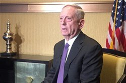 Defense Secretary James Mattis speaks to reporters at a hotel in Abu Dhabi, during his first trip to the region as Pentagon chief, on Sunday.