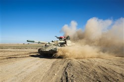 Tanks and armored vehicles of the Iraqi forces, supported by paramilitaries, advance toward the village of Sheikh Younis, south of Mosul, after the offensive to retake the western side of Mosul from Islamic State extremists commenced Sunday.