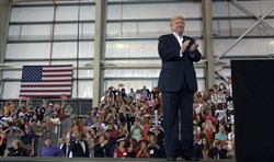 "President Donald Trump waits to speak at his ""Make America Great Again Rally"" at Orlando-Melbourne International Airport in Melbourne, Fla., on Saturday."