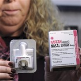 Pennsylvania Physician General Rachel Levine holds a sample of Narcan Nasal Spray following a demonstration on how to fill a prescription at Walgreens Pharmacy in Wilkes-Barre, Pa., on Feb. 10. Naloxone also comes in a nasal spray and an injectable for health care professionals.