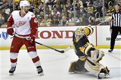 Penguins goaltender Matt Murray stops a shot in front of the Red Wings' Darren Helm in the second period Sunday at PPG Paints Arena.
